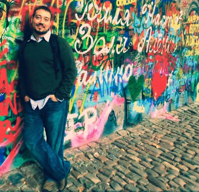 Me at the John Lennon wall in Prague, Czech Republic